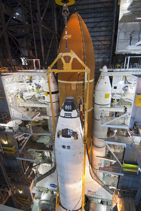 Endeavour is lowered into place next to its external tank and solid rocket boosters. Credit: NASAKennedy